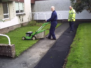 Grass cutting work at the KC Centre in Hawick